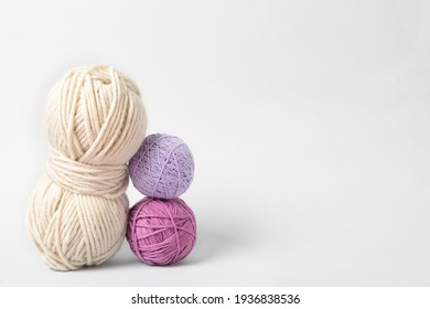 Soft colorful woolen yarns on white background