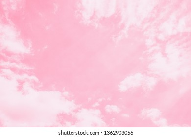Soft delicate pink sky background. Beautiful romantic sky with white clouds. Copy space, toned photo