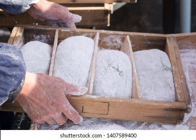 Soft dough shaped into mochi rice cakes during Mochitsuki ceremony at a local house in Otsu city, Shiga prefecture, Japan before the New Year
