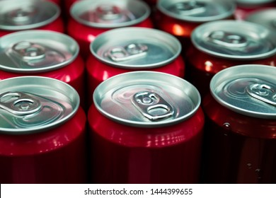Soft drink cans in fridge