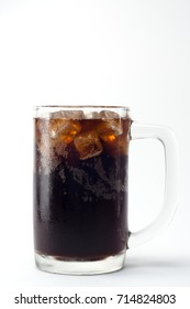 soft drink with ice in the cold glass on white background