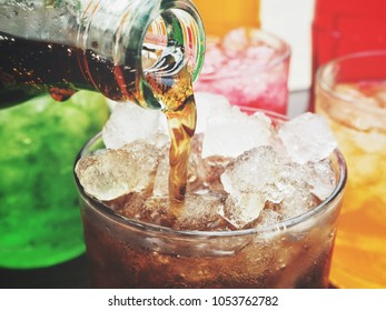 Soft drink with ice cubes