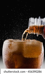 Soft drink : pour soda to a glass / focus at bottle