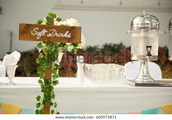 Soft Drink Sign at Outdoor Wedding