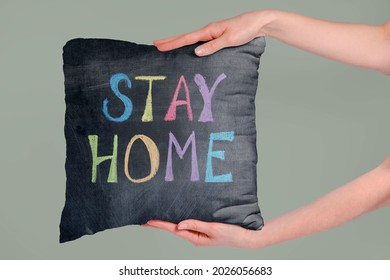 Soft fabric pillow holding by hand with stay home text - Shutterstock ID 2026056683