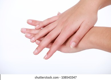 Soft feminine female hands with french manicured nails