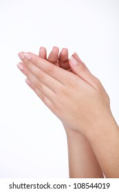 Soft flawless female hands with well manicured french nails in salon or spa