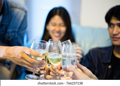 ?blurry and soft focus of Asian group of friends having party with alcoholic beer drinks and Young people enjoying at a bar toasting cocktails.
