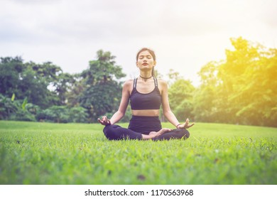 Soft focus Attractive Beautiful woman Young female in sportswear workout  during the morning training and runner jogging outdoors, Healthy young woman warming up outdoors
