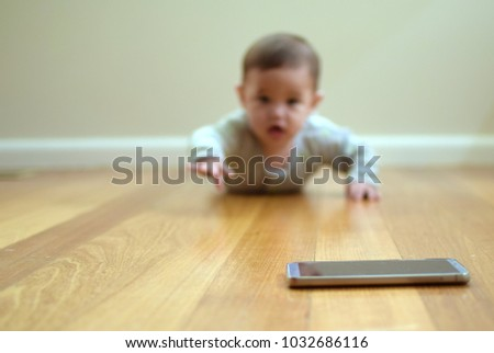 Soft Focus Baby Crawling On Wooden Stock Photo Edit Now 1032686116
