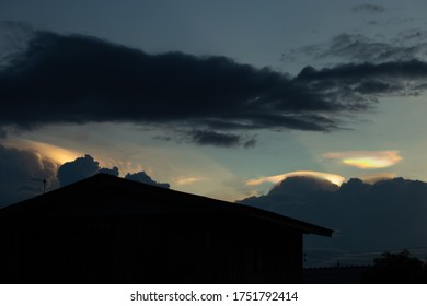 Soft focus of beautiful Pileus cloud or rainbow clouds and ray of sunlight in the evening. Pileus in Thailand 8th June 2020. Rainbow clouds above the rain clouds.