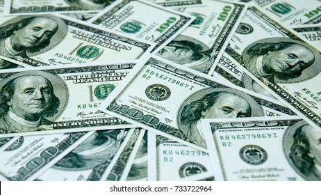 Soft focus and blurred rotating US banknotes background.