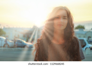Soft Focus blurry portrait of cute woman in sunset sunrays backlit image