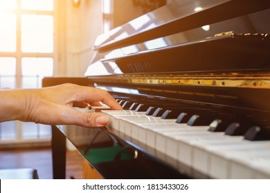 Soft Focus and Blur,The pianist is fixing and adjusting the sound of the piano correctly and precisely so that the practice and performance of the piano will be melodious and without glitches.
