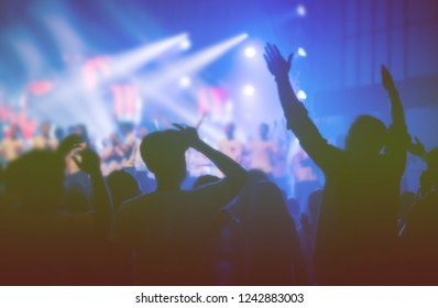 Soft focus of Christian worship with raised hand at church,music concert.