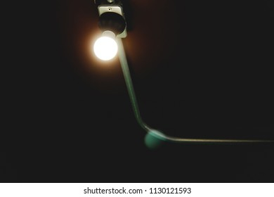Soft focus to Classic Retro light bulb cling to the brick wall and wiring with gray iron pipe. Illuminate help guide the vision for smooth picture.Vintage night Tone Style.