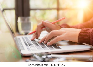 Soft focus Closeup woman hand working on her laptop. Social networking technology concept.