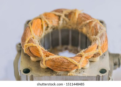Soft focus the coil electric fan, copper wire, electric motor and stator parts, on white background.How to do it by yourself.
