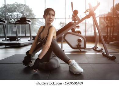 Soft focus consept women are exercising in gym fitness. Beautiful women in good shape from taking care of their bodies. Health concept.