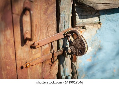 Soft focus. Countryside. The door is the entrance to the barn. Locked on an old retro castle. Horizontal frame. Color image .. Photo taken in Ukraine, Kiev region