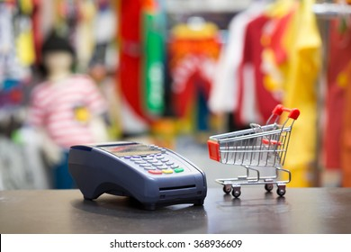 Soft Focus : Credit Card Machine With Shopping Cart In The Store