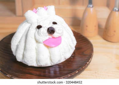 Soft Focus of Cute White Puppy Head of Milky Cream Cake on a Plate, Made From Fresh cream