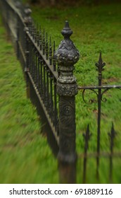 soft focus effect on antique iron fence