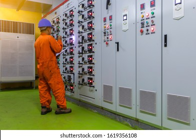 Soft focus of Engineer checking and monitoring the electrical system in Electrical switch gear at Low Voltage motor control center cabinet room,Electrical selector ,button switch  industry concept