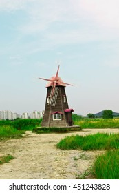 Soft focus Field of grass and blurred of traditional dutch old wooden windmill