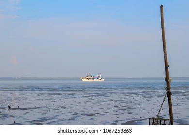 Soft focus fishing boat anchored in the sea