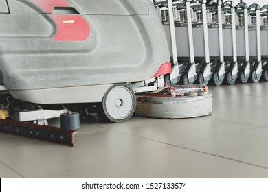 Soft focus of floor scrubbing and floor cleaning services with floor scrubber or floor cleaning Machine in airport.Commercial cleaning services.