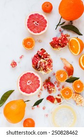 Soft focus - Fresh Citrus fruits and orange juice onto an marble background, top view. Organic,health y beverage.Vitamin drink. Citrus fruit background. Mediterranean diet.