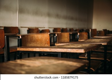soft focus front view abstract background old lecture chairs in examination room or classroom in poor school with out students inside.concept for education in third world ,donate and charity