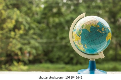 soft focus globe in unfocused green trees background