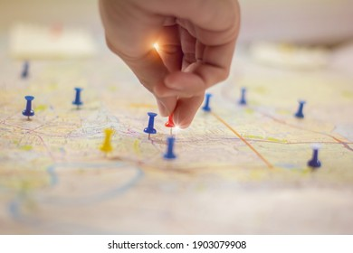 Soft focus hand holding paper pin on blur perspective road map,copy space.filter color effect.