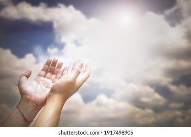 Soft focus of hands of human are pray and worship on blue sky background with sunlight, Soul of prayer man, Spirituality with believe and religion