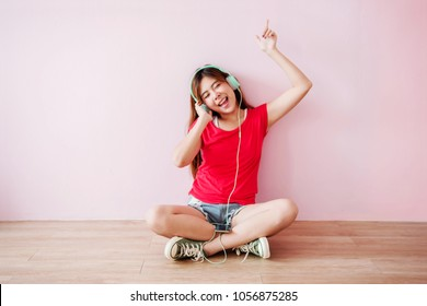 Soft Focus of Happy Young Woman Listening Music From Mobile Phone in House, Sit on the Floor, Closed Eyes and Smiling