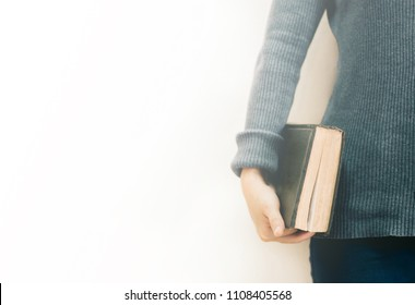 Soft focus holding the bible in hands with copy space.