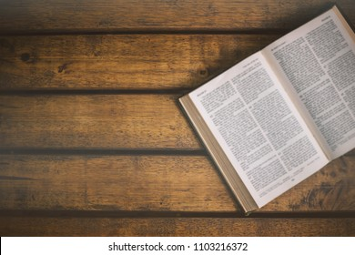 Soft focus The holy bible on wood table with copy space.christian background