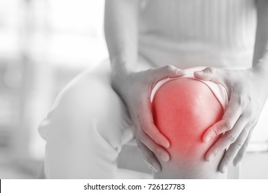 Soft focus of  knee joint  of woman get hurt and pain in white black tone.