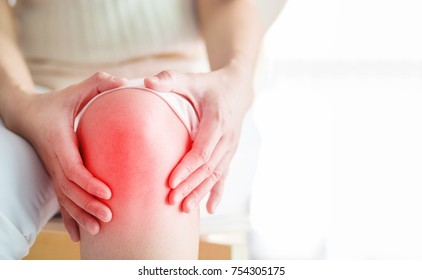 Soft focus of  knee joint  of woman get hurt and pain.