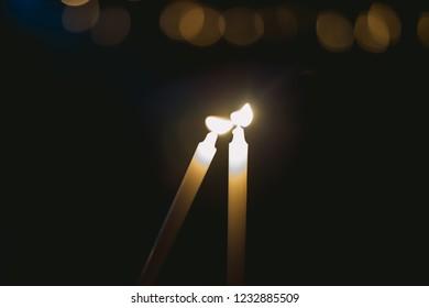 soft focus lighting candle vigil in darkness seeking hope.