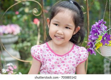 Soft focus ,Lovely asian girl in his garden