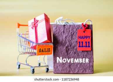 Soft focus mini shopping cart and shopping bags with label tags ,China 11.11 single day sale concept.