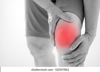 Soft focus of Old Asian women to knee injury on white background,black and white tone
