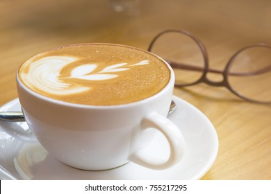 Soft focus on capuccino coffee cup, coffee for background - vintage effect process picture