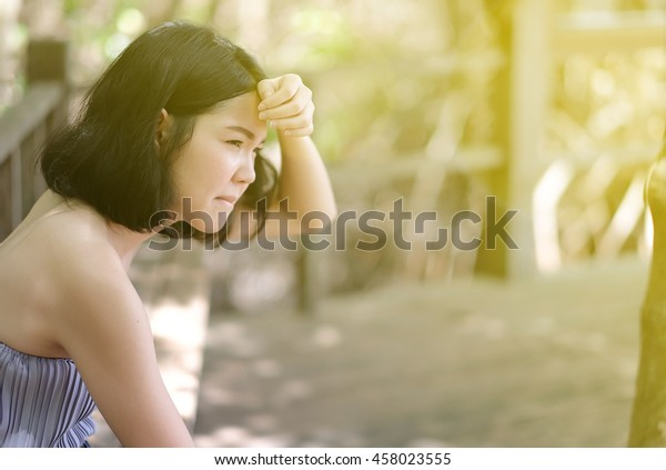 soft focus on a hot woman feel heat because of hot weather with sun flare