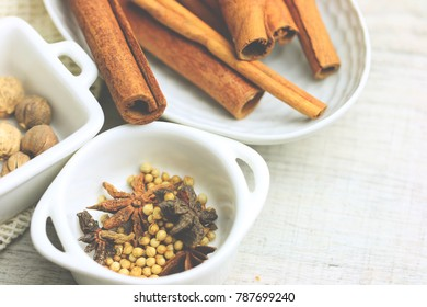 Soft focus on Retro mood-tone of asian dry herbals spice set : cinnamon stick, star anise, coriander seed and galangal on gray vinyl floor cop6 space