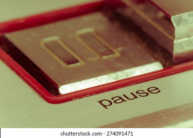 soft focus pause button, focusing on the word pause, vintage style