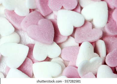 Soft focus pink and white heart candy pastel background for Valentines day